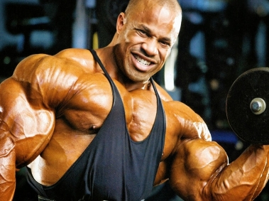 Bodybuilder with Huge Muscles Lifting Weights