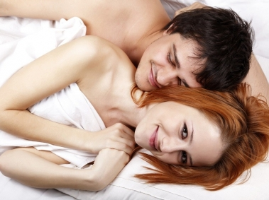 Man Laying in Bed with Woman