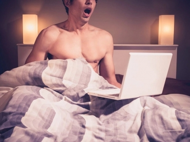 Man in Bed With Laptop