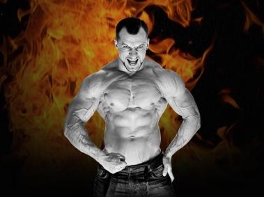 BodyBuilder Flexing infront of Fire
