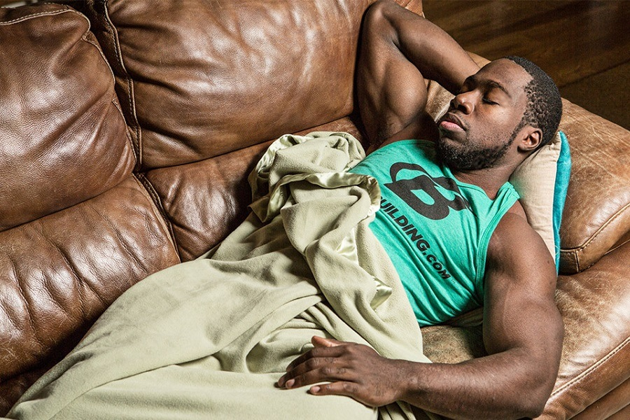 Bodybuilder Sleeping on a Couch