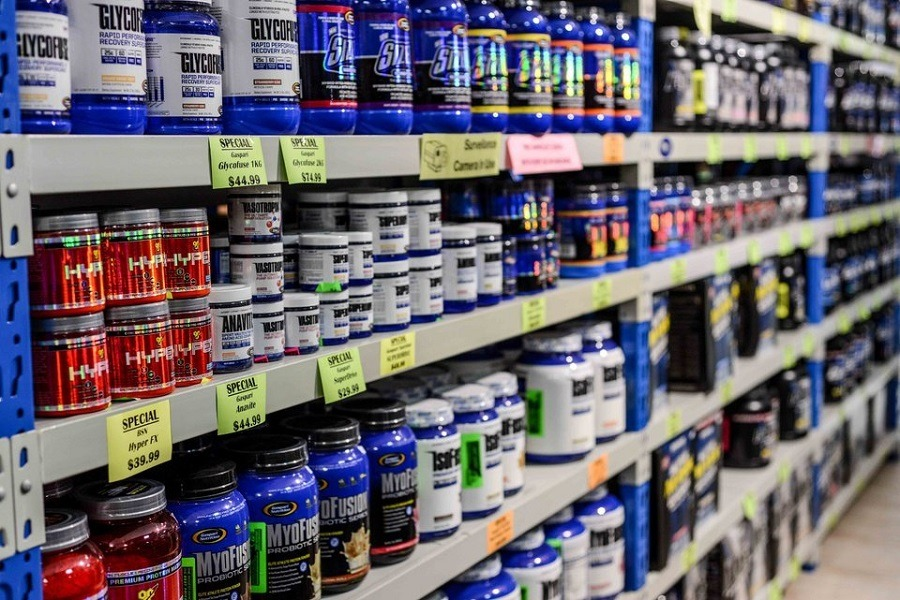Store Shelf With Supplements for Muscle Gain