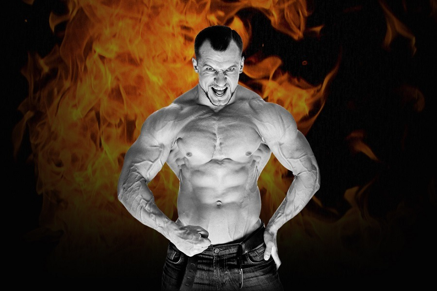 BodyBuilder Flexing infront of Fire